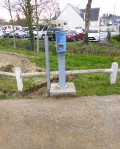 Installation d'un totem pour gérer les entrées / sorties du parking